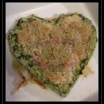 Cuor di risotto spinaci e panna gratinato su letto di lardo croccante