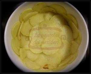 Filetti di nasello con sfoglie di patate
