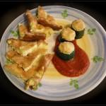 Frittata al forno con patate e zucchine accompagnata da zucchine ripiene vegetariane
